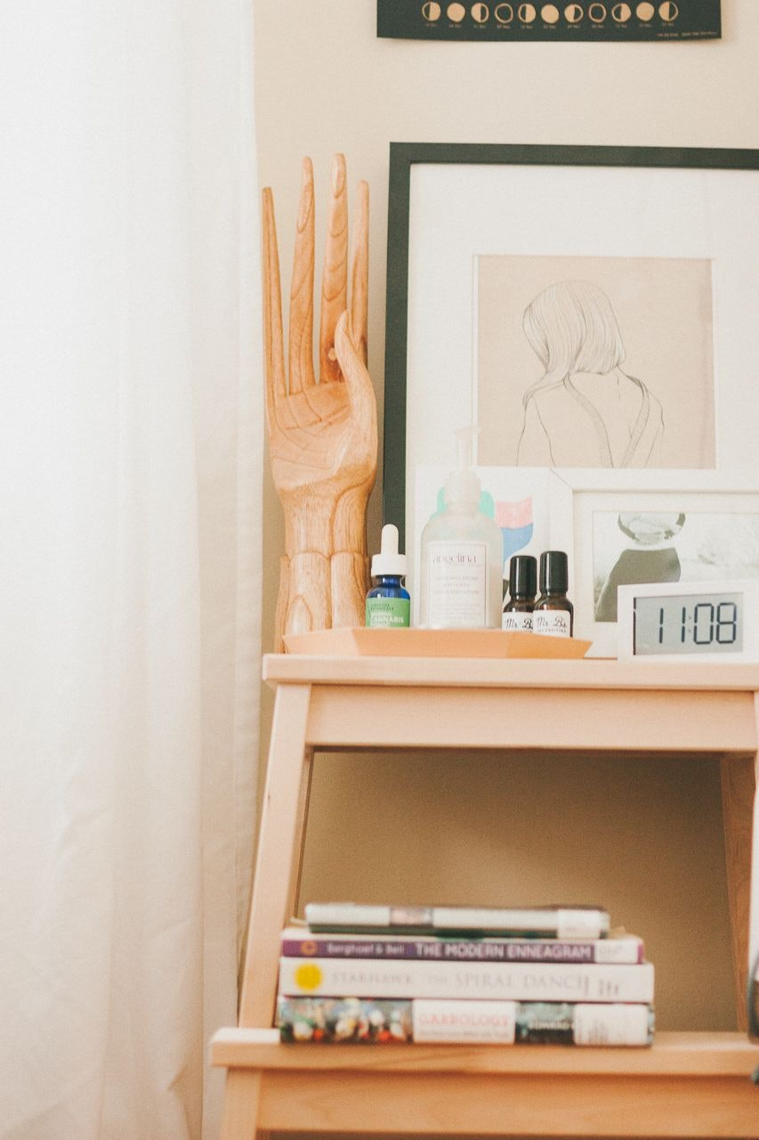 Stack of Books on Bedside Table by Conscious by Chloé
