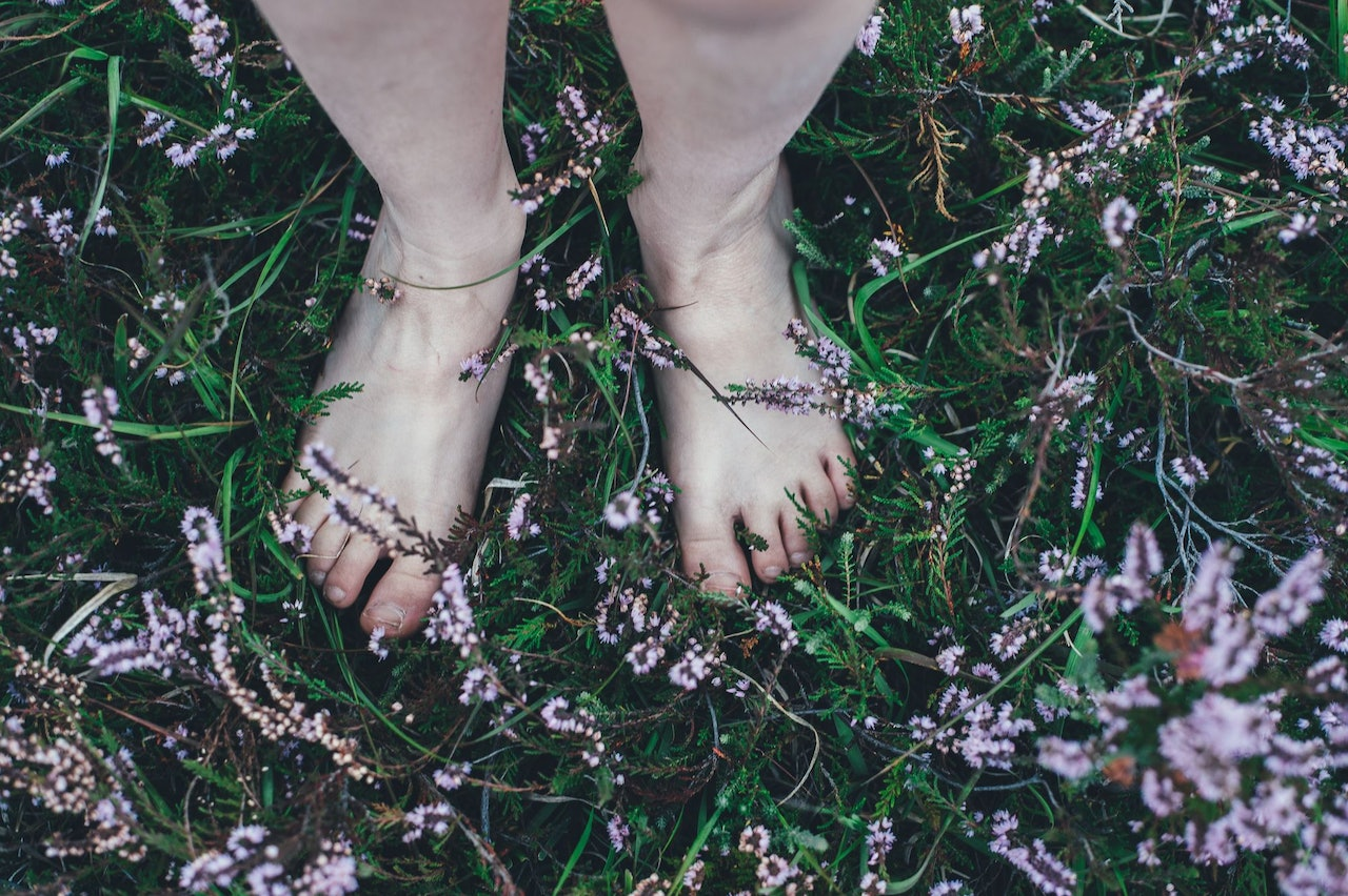Barefoot in the Grass by Annie Spratt for Conscious by Chloé